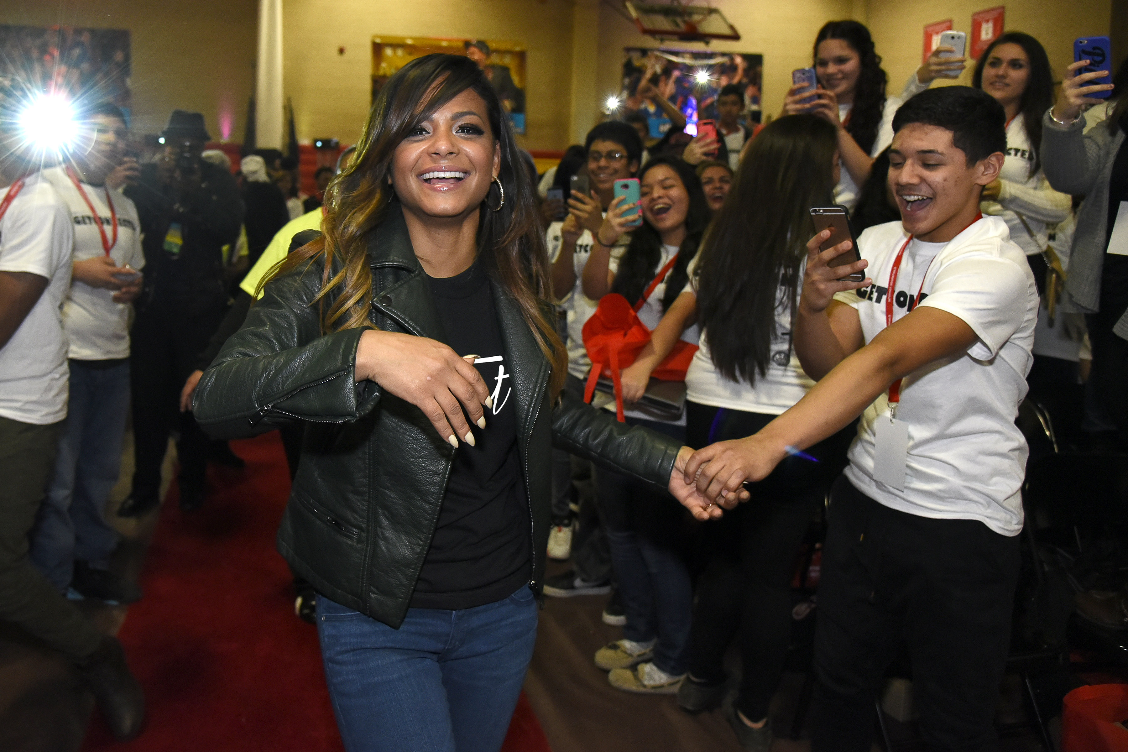 Christina Milian makes her way to the stage at the Get Schooled, Get Connected Celebration. Christina has a new show that aired on E! this past Sunday.