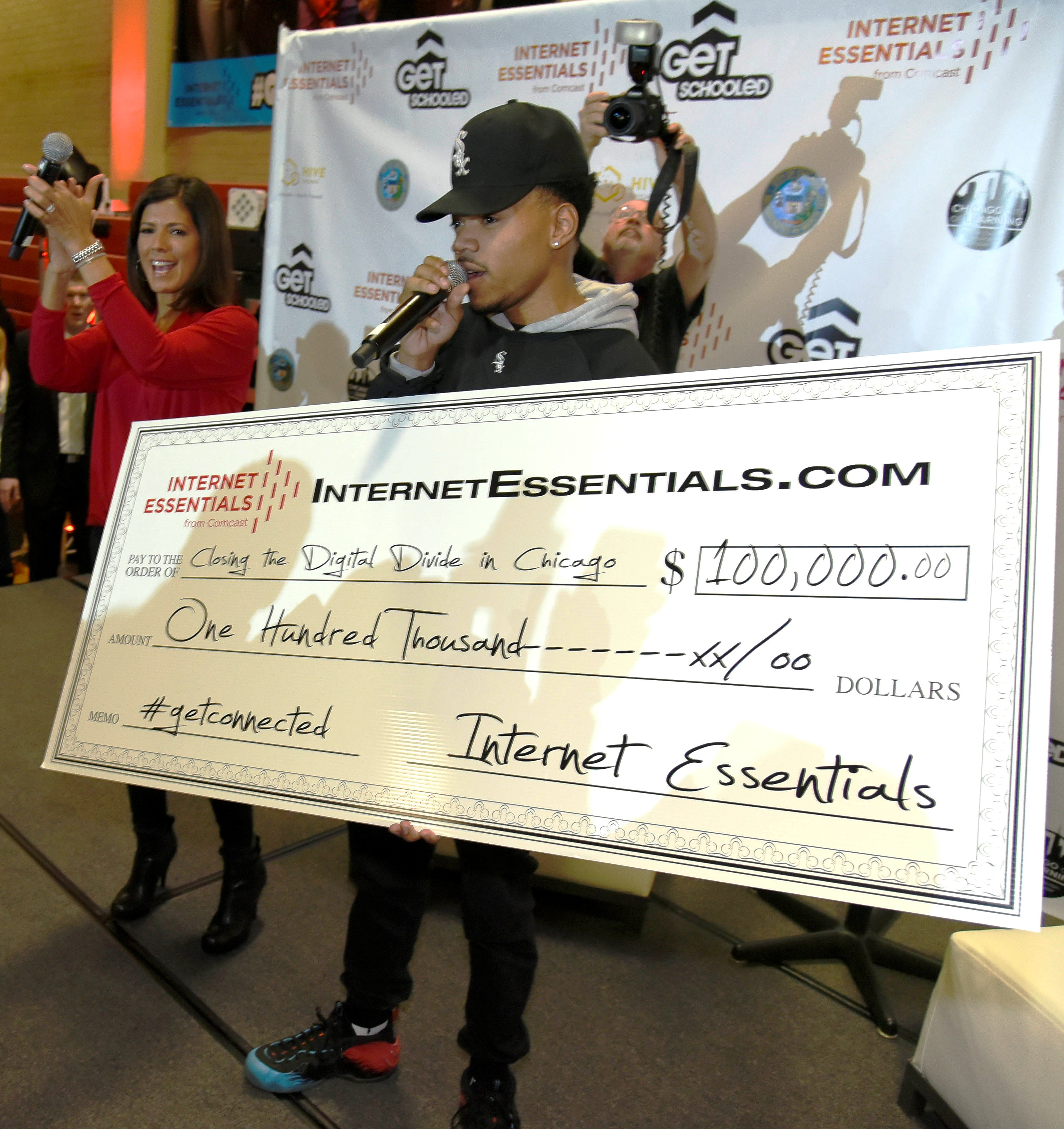 Chance the Rapper makes a $100,000 check presentation to six Chicago Public Schools and six community-based organizations apart of the Get Schooled, Get Connected Celebration.