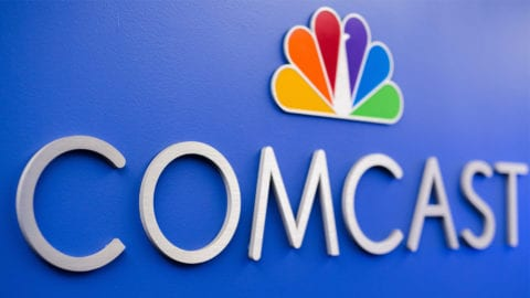 Comcast logo on the wall