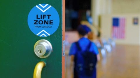 A Lift Zone sticker on a community center door
