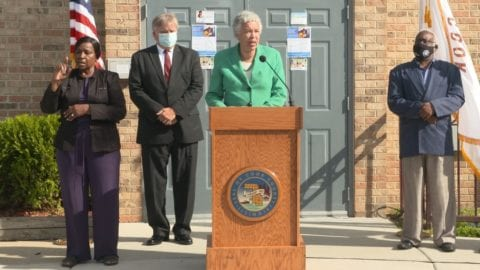 Housing Authority of Cook County representatives at a podium